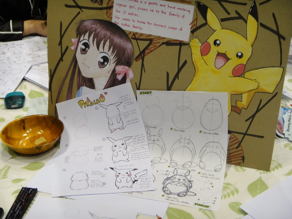 Pokemon and manga drawing. Looks very interesting. Pikachu looks so cute. Photo by Sue Chen.