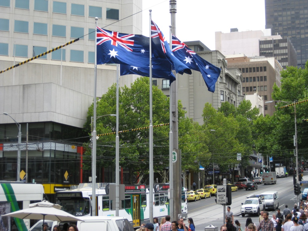 The Australian flag(s) flies high in Melbourne's Bourke Street. What does being Australian mean, and what does being Asian-Australian mean? Photo by Mabel Kwong.