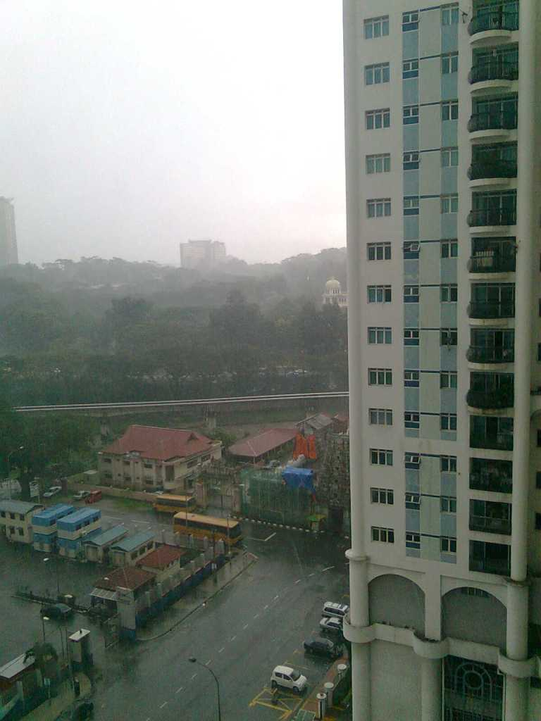 Many people in developing countries live in sub-par housing, unlike those in Western cities. Rainy KL, Malaysia. Photo by Mabel Kwong.