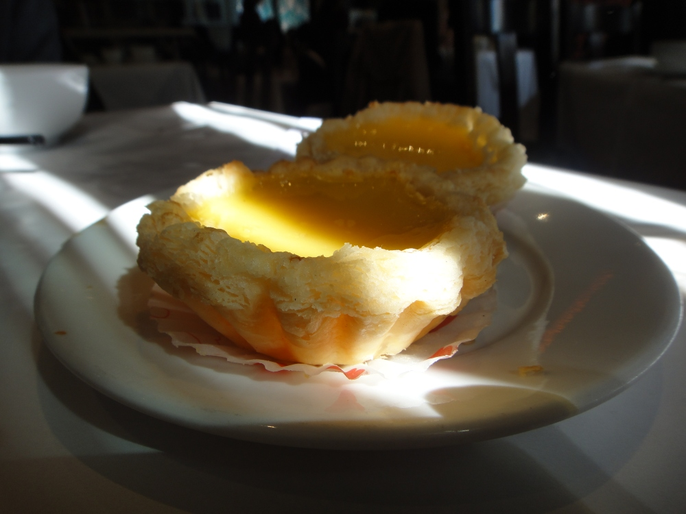 A ray of sunlight falls over an egg tart. Who doesn't like a good, sweet egg tart? Photo: Sue C.