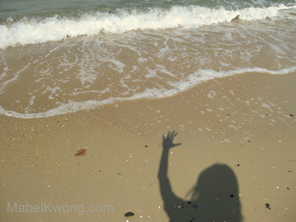 Giving myself a high five at the beach   Weekly Photo Challenge: Selfie. Photo: Mabel Kwong