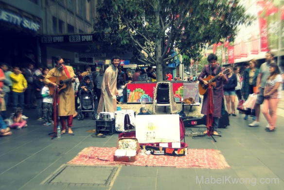 Three buskers, three instruments and three Sri Lankan outfits. | Weekly Photo Challenge: Threes.