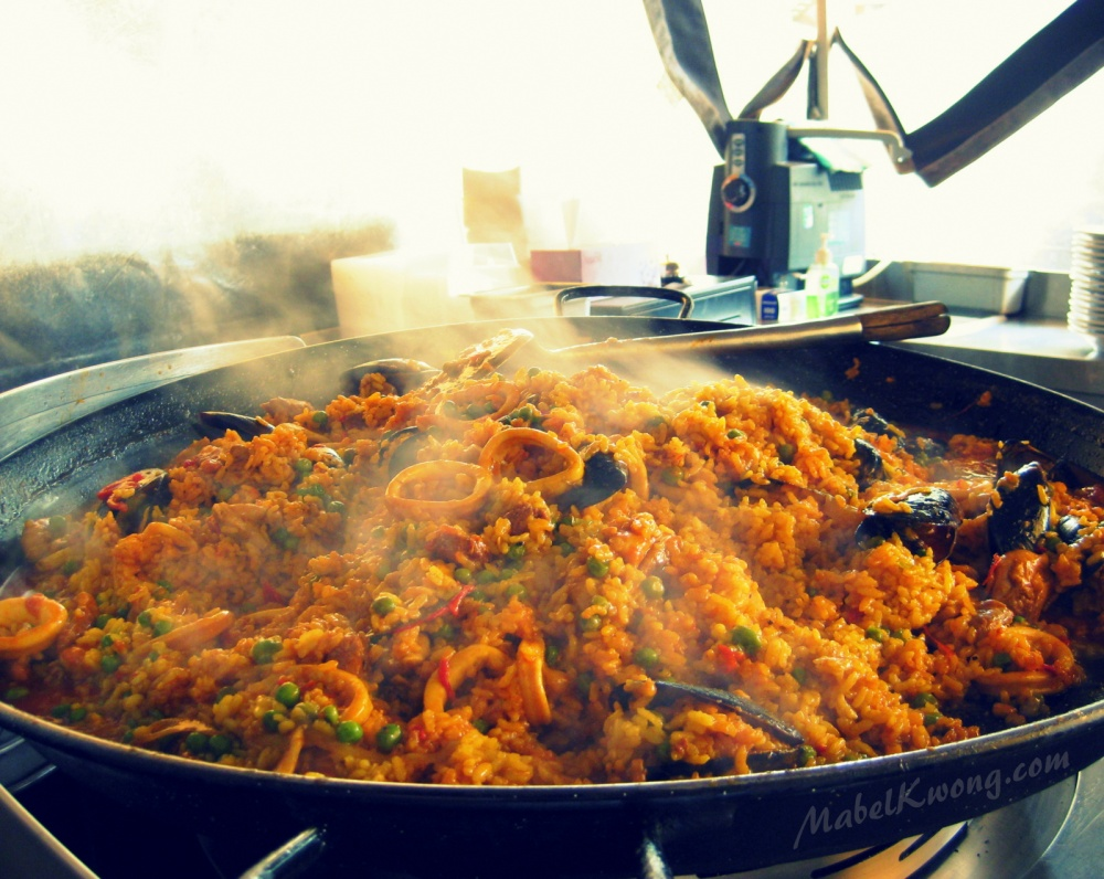 Seafood paella inside a hot pan on the street. Dare eat it? | Weekly Photo Challenge: Inside.