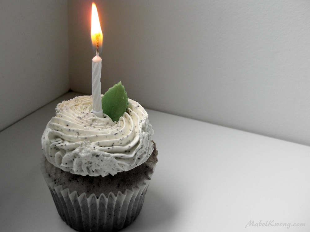 Candles on a cake spell out the invisible letters 'Happy Birthday' | Weekly Photo Challenge: Letters.