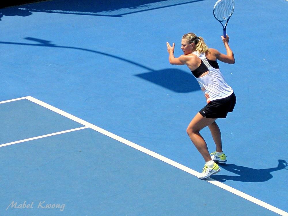 Maria Sharapova hits whizzing tennis balls during Australian Open tennis practice.