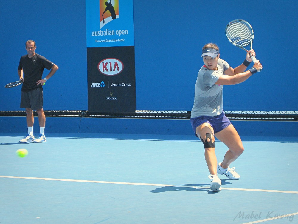 Li Na keeps an eye on whizzing tennis balls during Australian Open tennis practice | Weekly Photo Challenge: Blur.